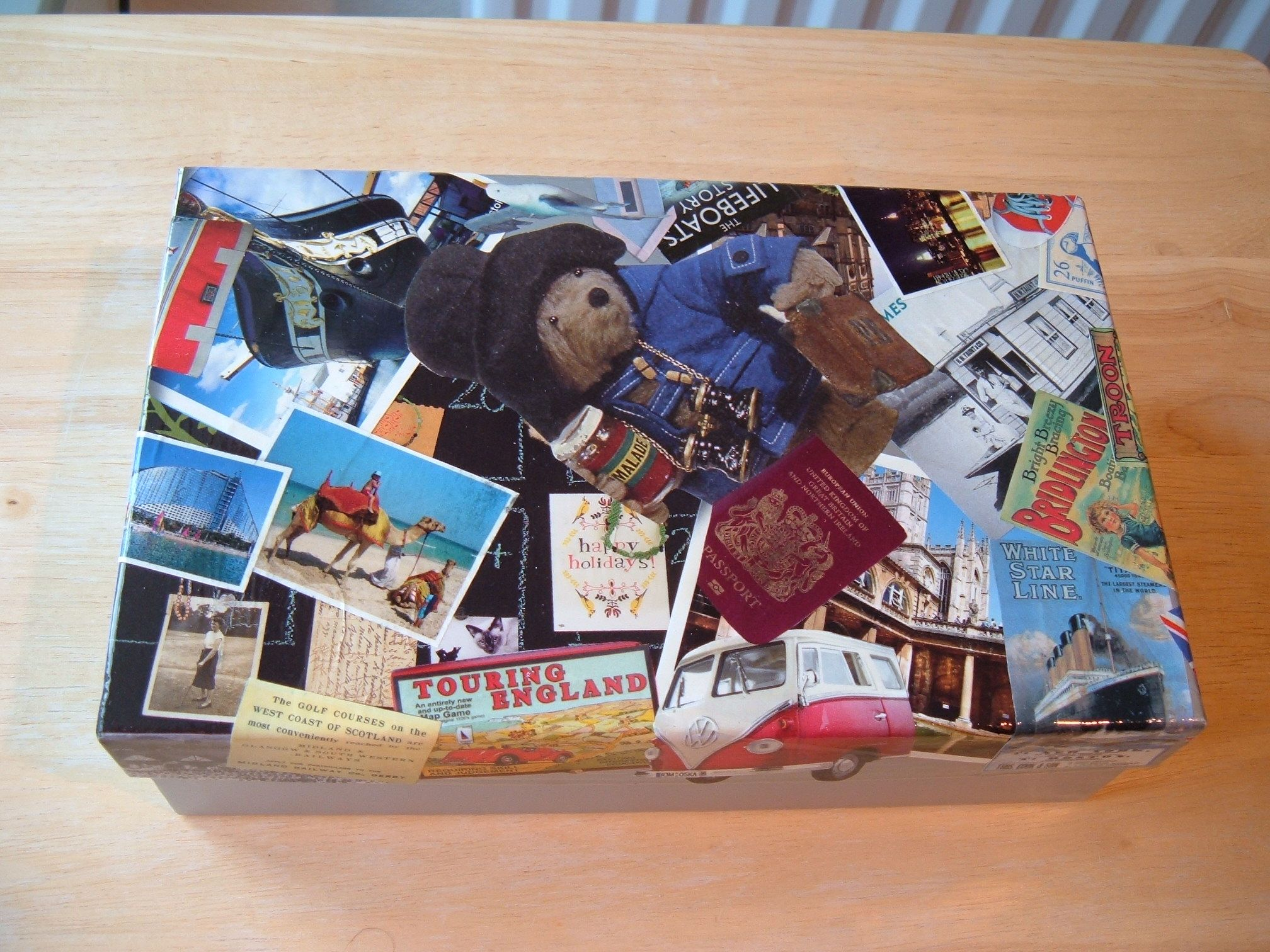 Covered in travel related magazine pictures to hold my postcards.
