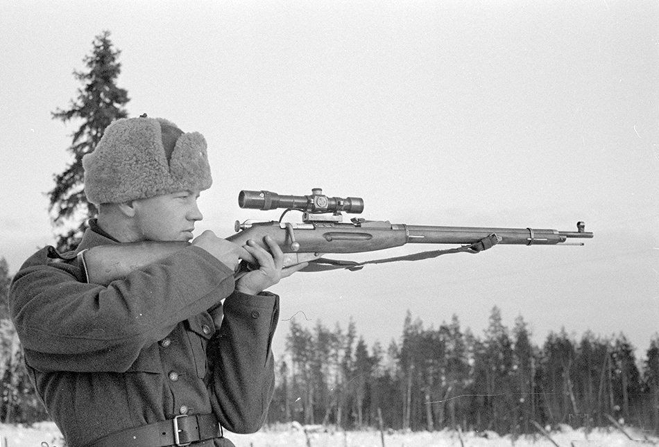 A Finnish soldier poses with a captured Soviet Mosin–Nagant sniper