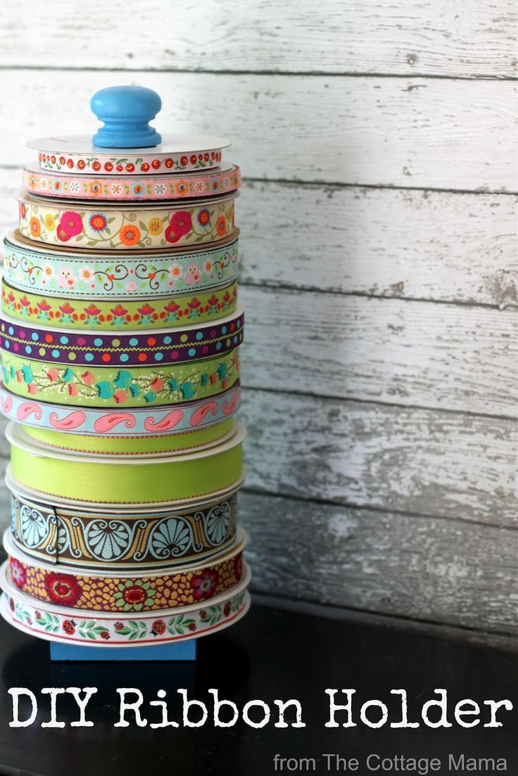 DIY Ribbon Organizer. Great inexpensive craft idea for your sewing room or craft room from The Cottage Mama. Organized storage!