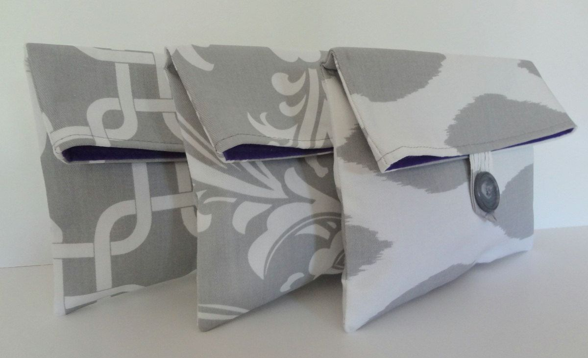Gray Bridesmaid Clutches in Storm Gray Prints Gotcha Ozborne Ikat - Set of 3 Medium Cosmetic Bags. $46.50, via Etsy.