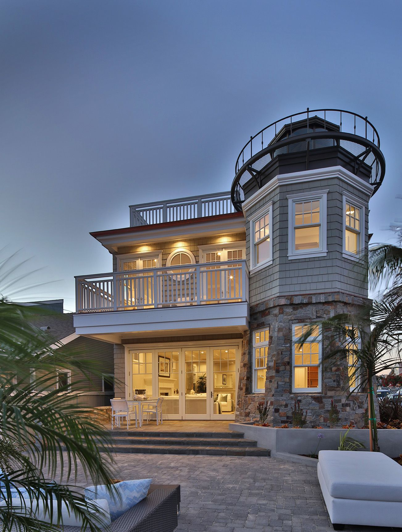 Beachfront Luxury Modern Home Exterior At Night: Coastal Modern Luxury Home Exterior With Lighthouse Feature