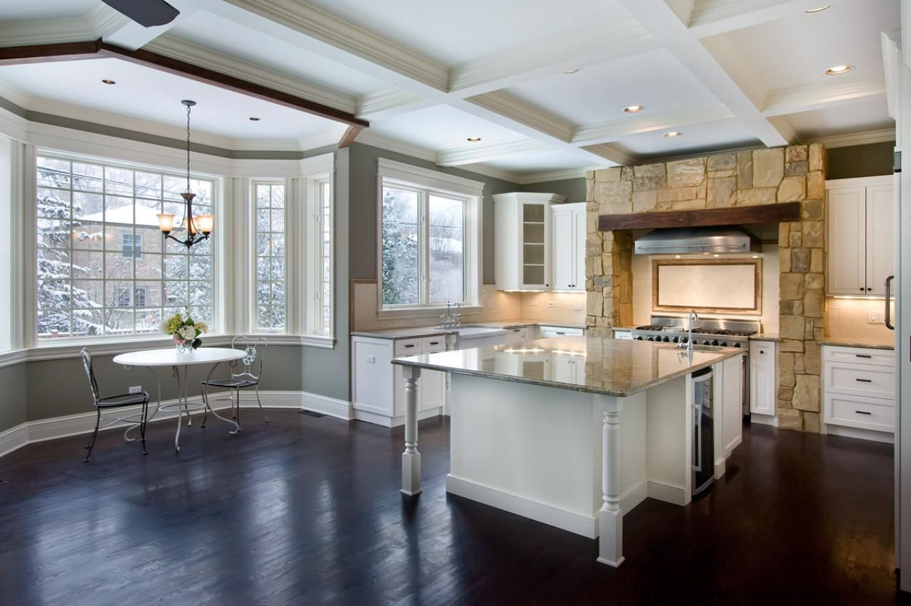 the open floor plan and large bay window make this large kitchen