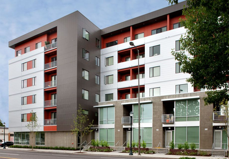 Portland Cement Architecture : Concrete townhouses at ground level flats above shaver
