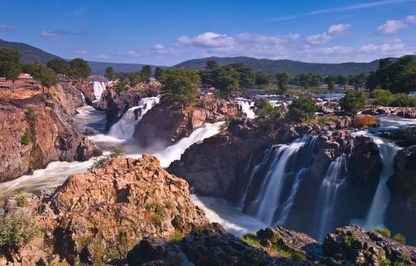 HOGENAKKAL FALLS, TAMIL NADU The falls is a waterfall on the river Kaveri and is often referred as the Niagara of India. Located around 180 km from Bangalore, these falls are a major tourist attraction.