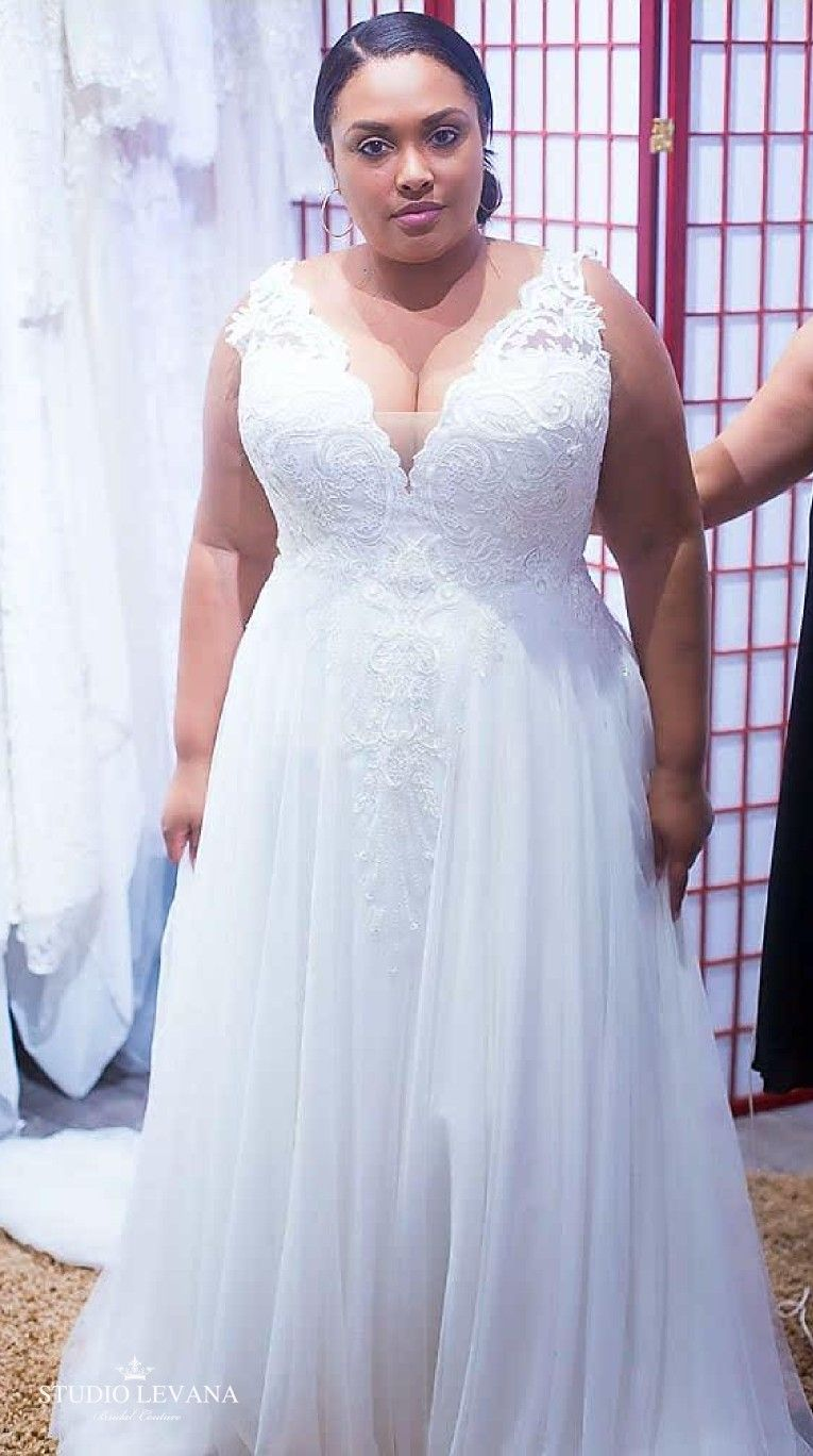 Plus size wedding gown with a deep V and a tulle skirt Tracie
