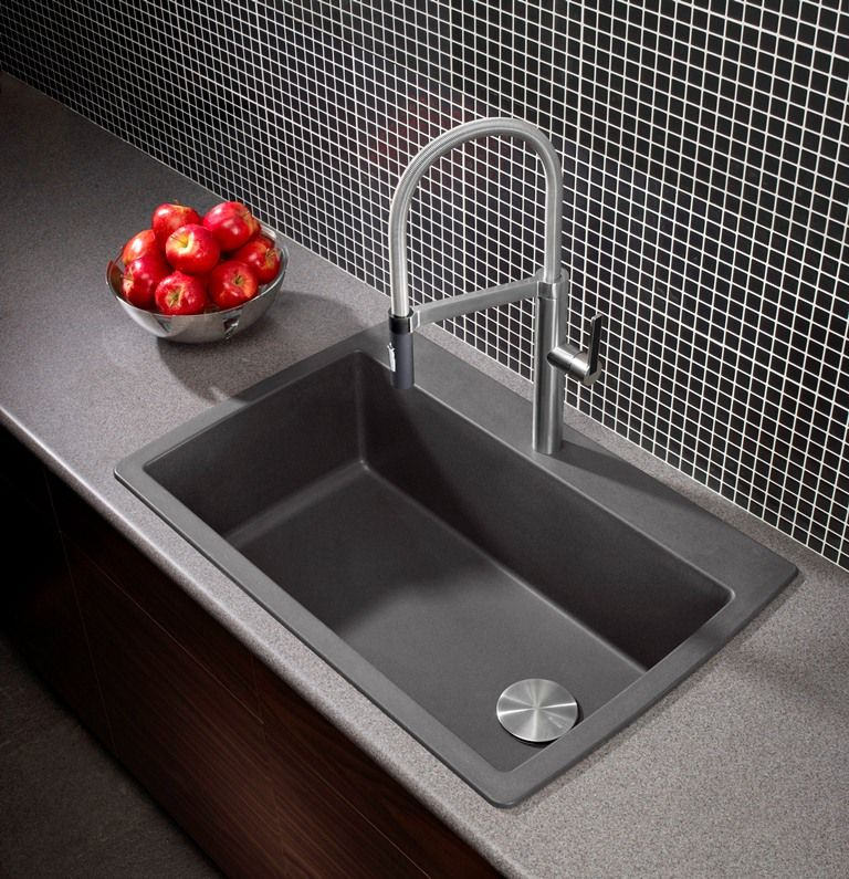A hot new colour for a sink: cinder grey. This Blanco sink also ...