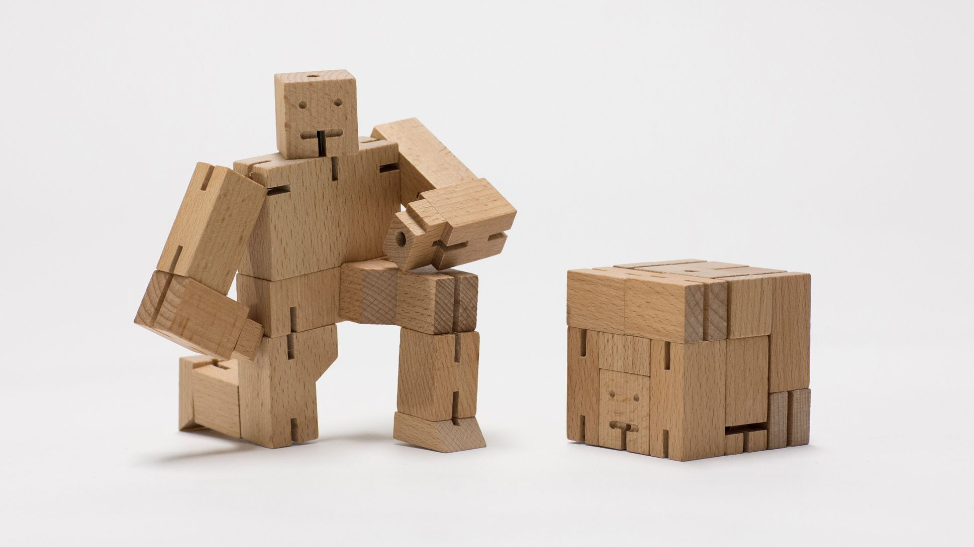 cubebot is a wooden toy robot with elastic joints that can