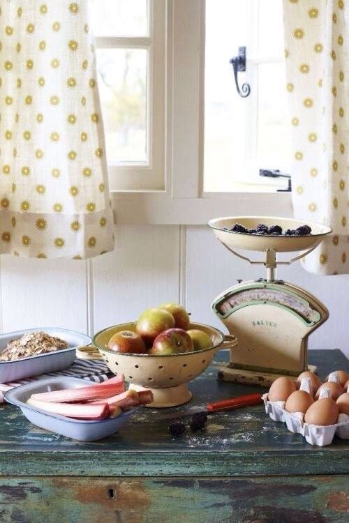 Farmhouse vignette with fruit and polka dotted curtains on the window