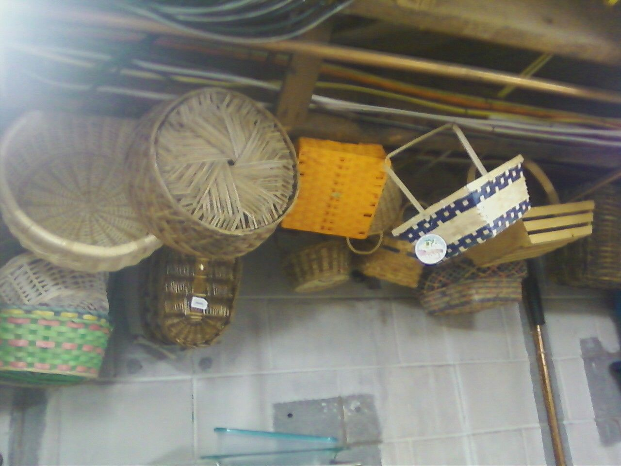 Neat way to organize and store baskets - hammer nails into the rafters of your storage room (leaving them sticking out about 1/2 way) and hang your baskets from the ceiling.