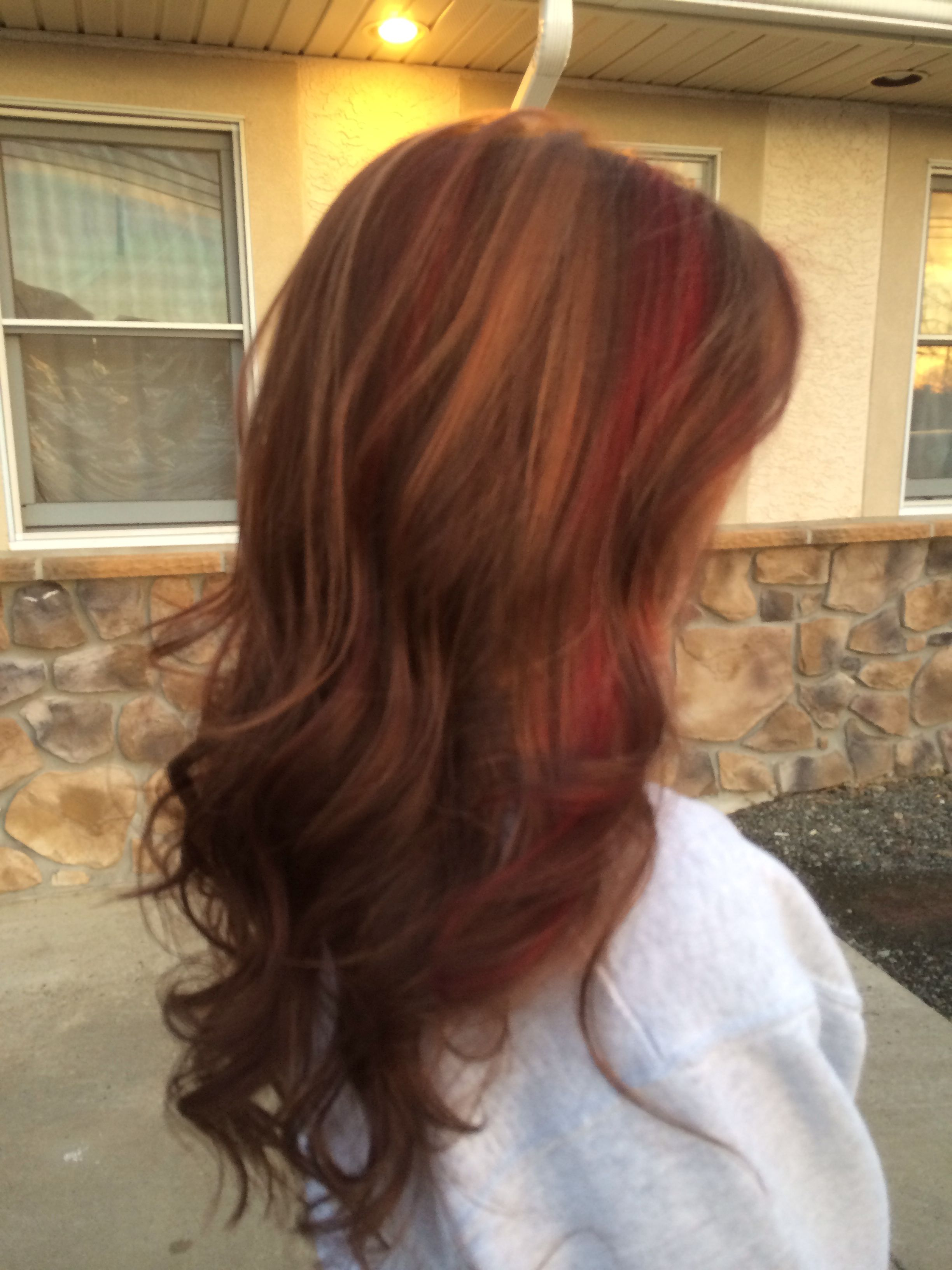 Dark brown hair with red and caramel highlights now this is style