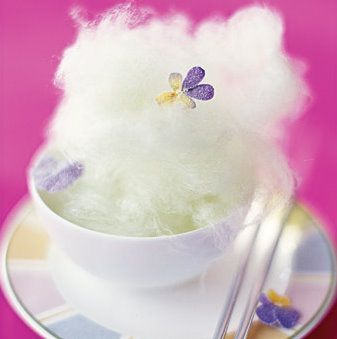 Candy floss in a tea cup, with edible flower, perfect for a unique whimsical wedding table setting