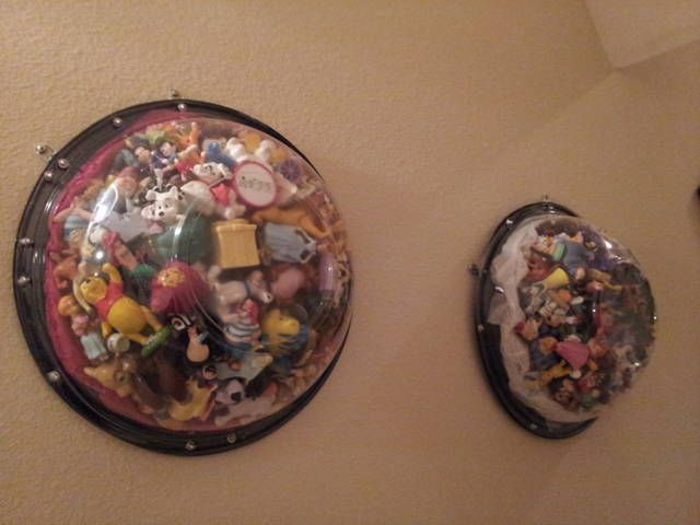 Caterers' Salad Bowl with lids secured with grommets.  This is a fun way to display (and store) all of the Disney PVC figures we've collected over the years. Would also work with Hot Wheels or other small toys you cannot bear to toss when kids get older.  :-)