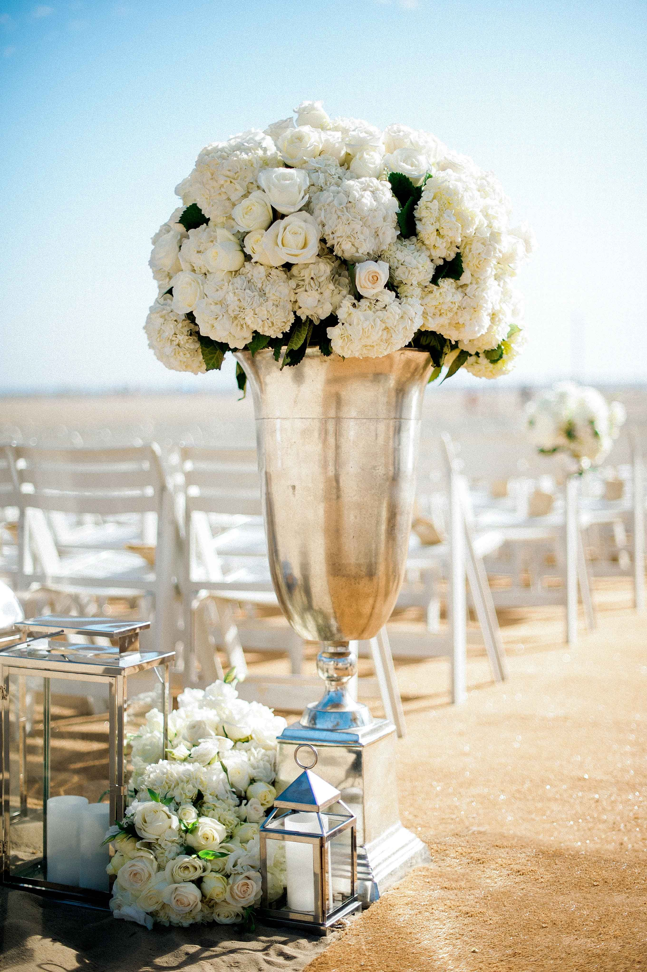 fe1e10424b Silver Urn with Ivory Blooms & Lanterns Photography: Yvette Roman  Photography Read More: