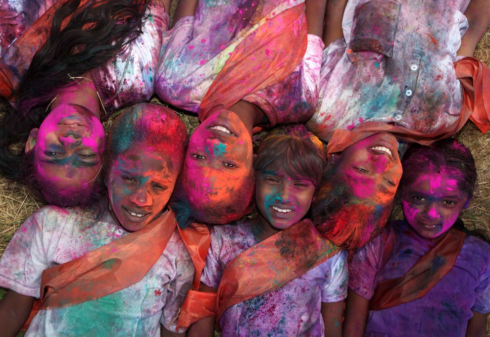 """children covered in colored powder called """"abir"""" during the celebration of Phagwa also known as Holi in Trinidad"""
