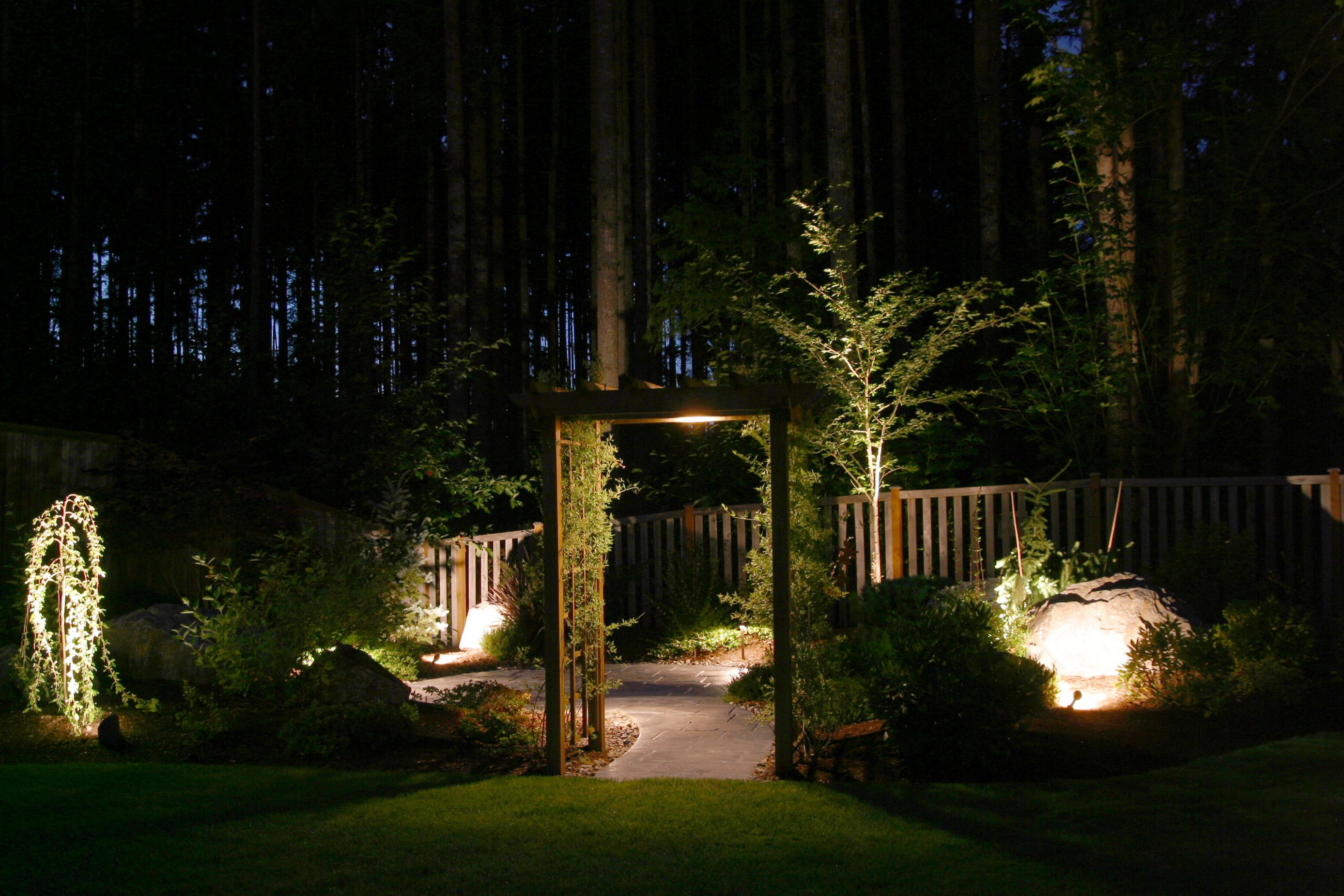 landscape lighting design to highlight your garden gate pergola or rh pinterest ca