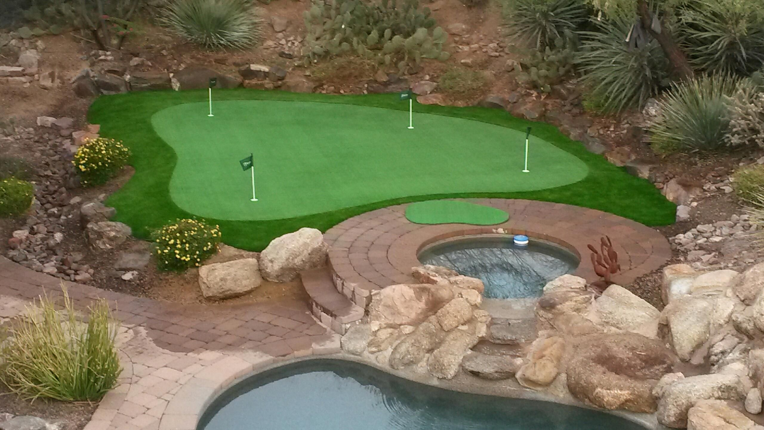 Putting green and pool perfect bo backyard golf landscaping