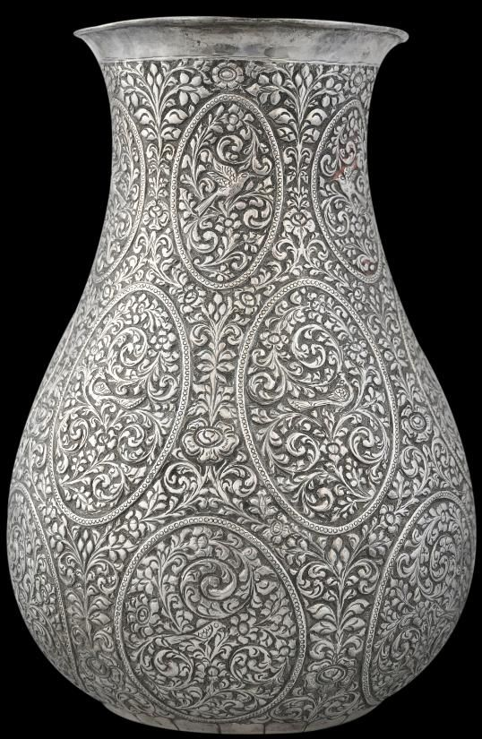 I love ethnic beaten silver vases. I've owned the same one form Mexico since I was 18.