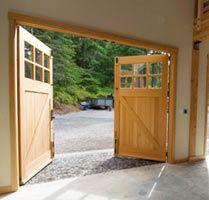 garage barn doorsReal carriage doors Interior Side Carriage Outswing Door  My home