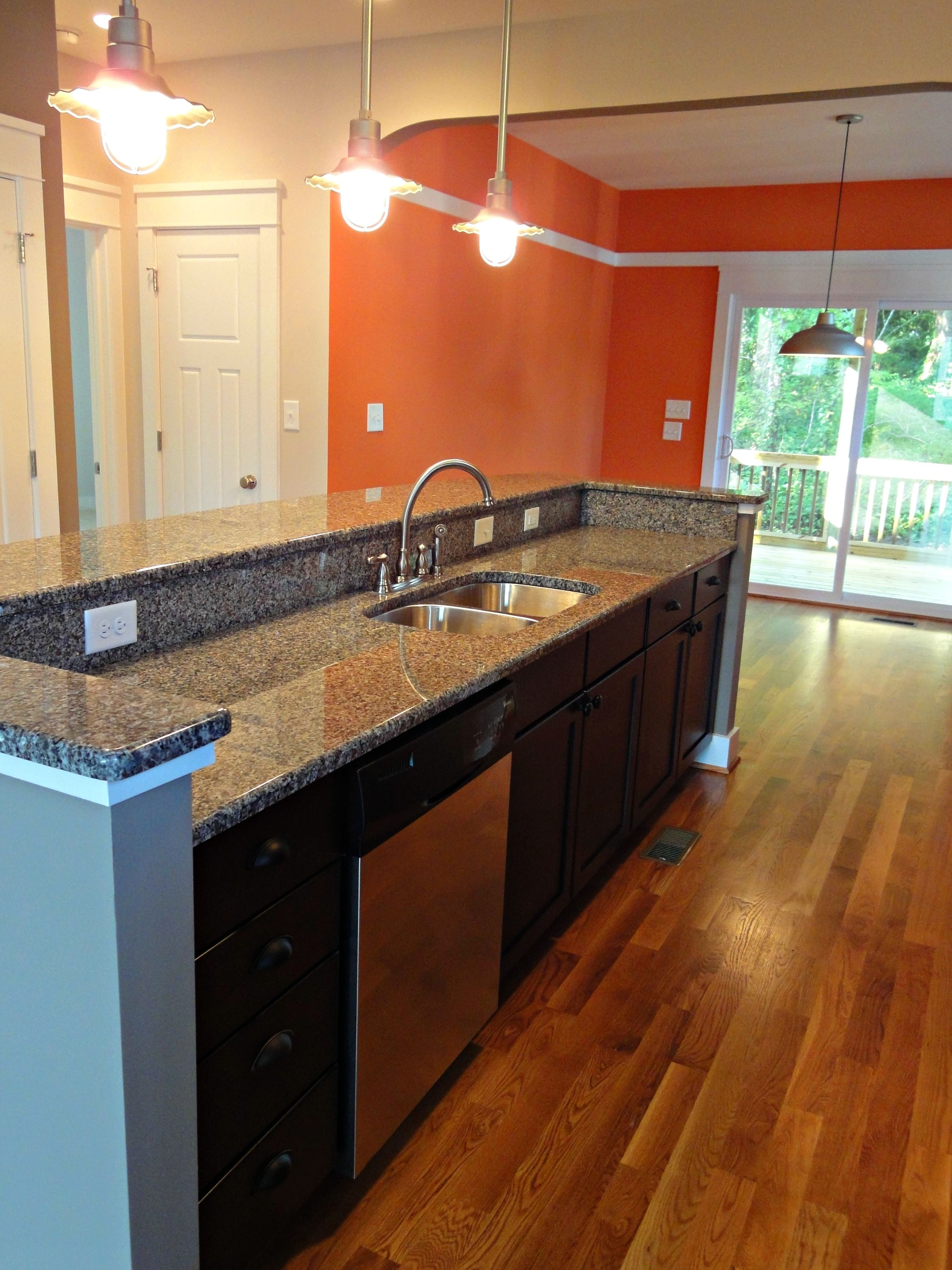 A Redfern Way, Durham, NC kitchen with barn lights and a ...
