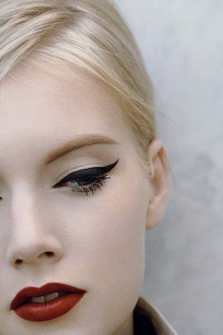 DAMN. Incredible makeup finish! Wish I knew which eyeliner and lipstick! P.S. You know they didn't photograph the other eye because they cou...