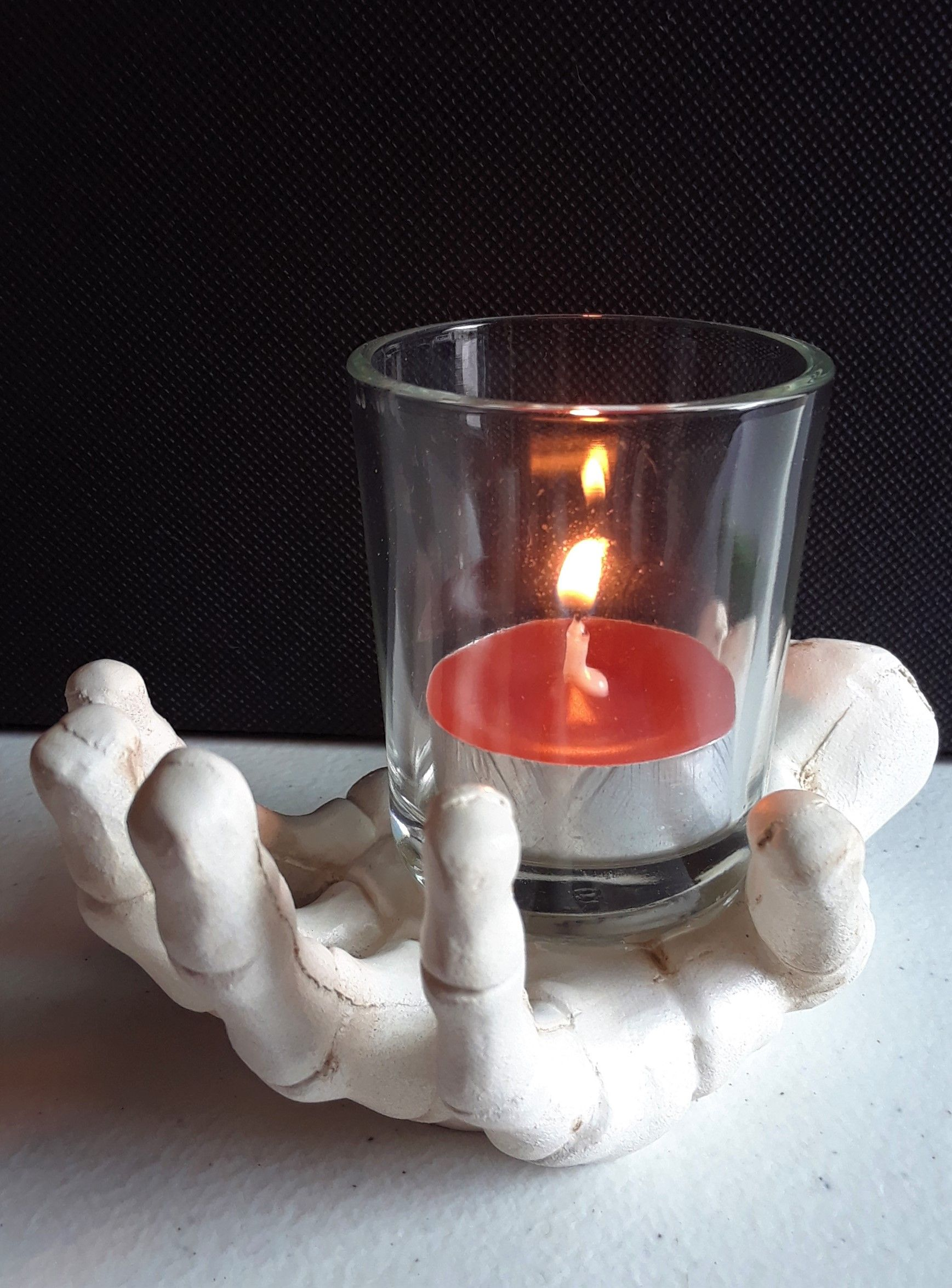Burning candles cast an eerie shadow in these creepy