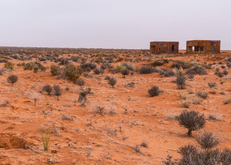 These cabins on the Navajo reservation are made of rusted steel and reclaimed barn wood
