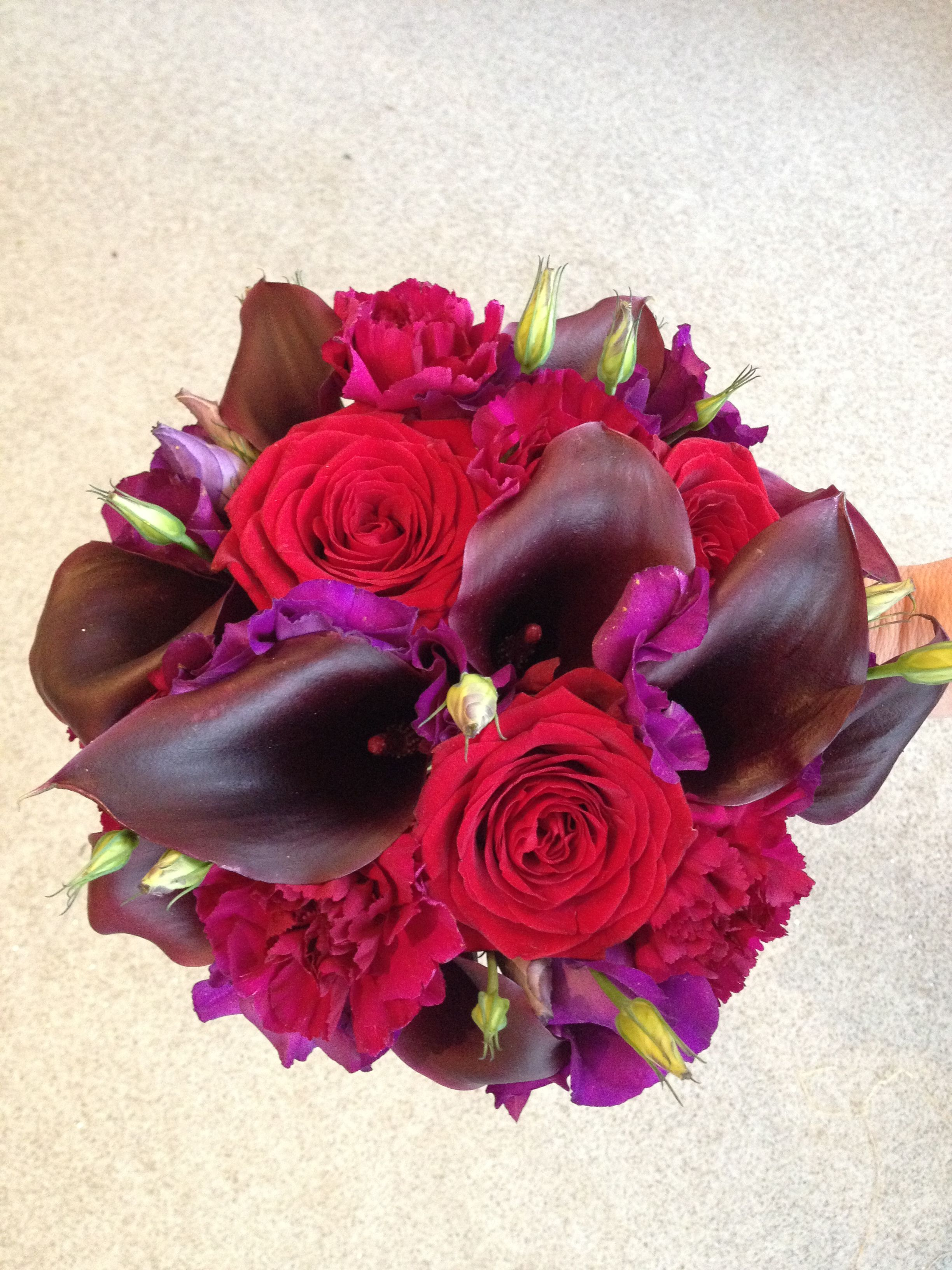 A Striking Passionflower Wedding Bouquet With Calla Lilies And Red