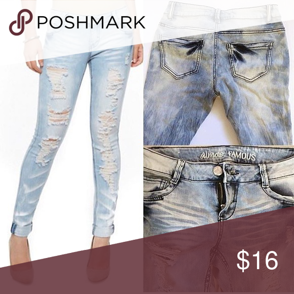 Rainbow Distressed Jeans Super stylish New without tags Almost Famous distressed jeans size 3.  Total length: 38 inches. Inseam: 30 inches. Waist: 12-14inch. Material 98% cotton and 2% spandex. True color is right photos. rainbow Shops Pants Skinny