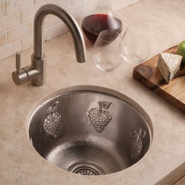 Copper Bar & Prep Sinks - Native Trails - Grapes - The engaging Grapes sink goes a step beyond the hand-hammering with its distinctive grapes motif (which is embossed by hand, of course). Ideal for a wine bar or prep area, Grapes is available in Antique, Natural, and hand-dipped Brushed Nickel finishes.