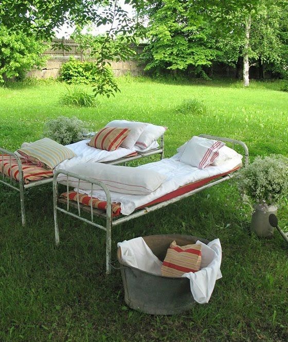 Vintage metal hospital beds used for outdoor nap time.