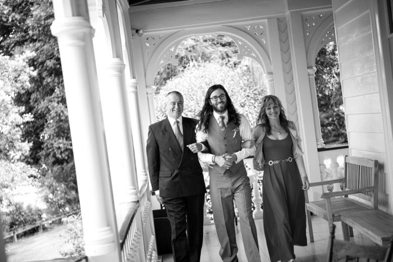 Groom arrives at the ceremony with his mother and father at a wedding at Alberton House, Mt Albert, Auckland. Black and white. BeSo Studios create beguiling fine art family photographs for the walls of the most discerning clients homes. We specialise in wedding and family portrait photography, and supply prints on the highest quality media, framed in beautiful conservation standard frames. We are a high end studio located in the beautiful city of Auckland, New Zealand.