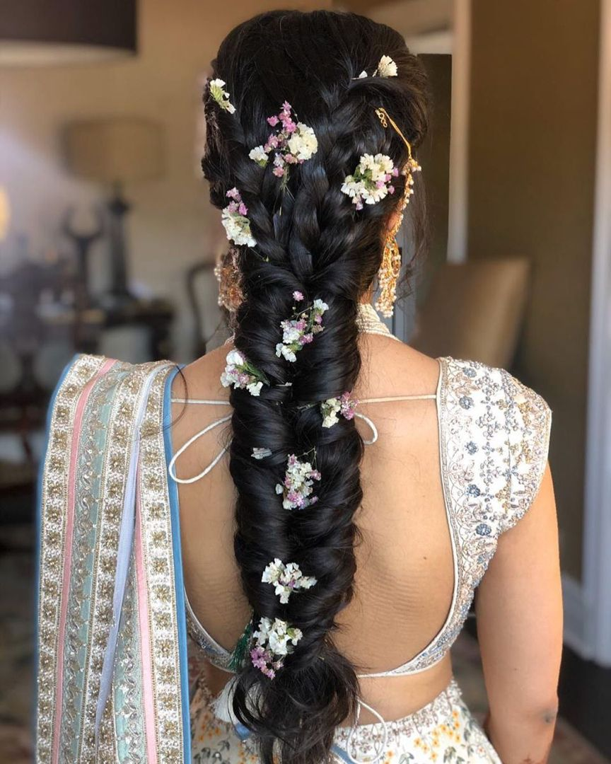 Messy Braids with flowers for Brides | Hair styles, Loose braid hairstyles,  Indian bridal hairstyles