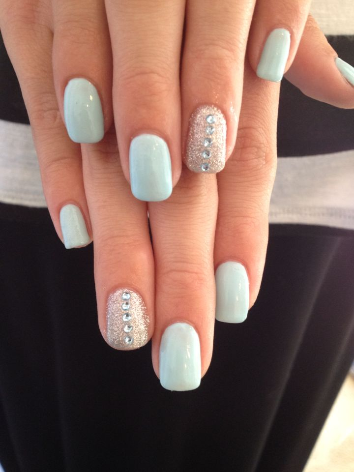 Super prettyTiffany Blue Gel Nails with gold glitter and