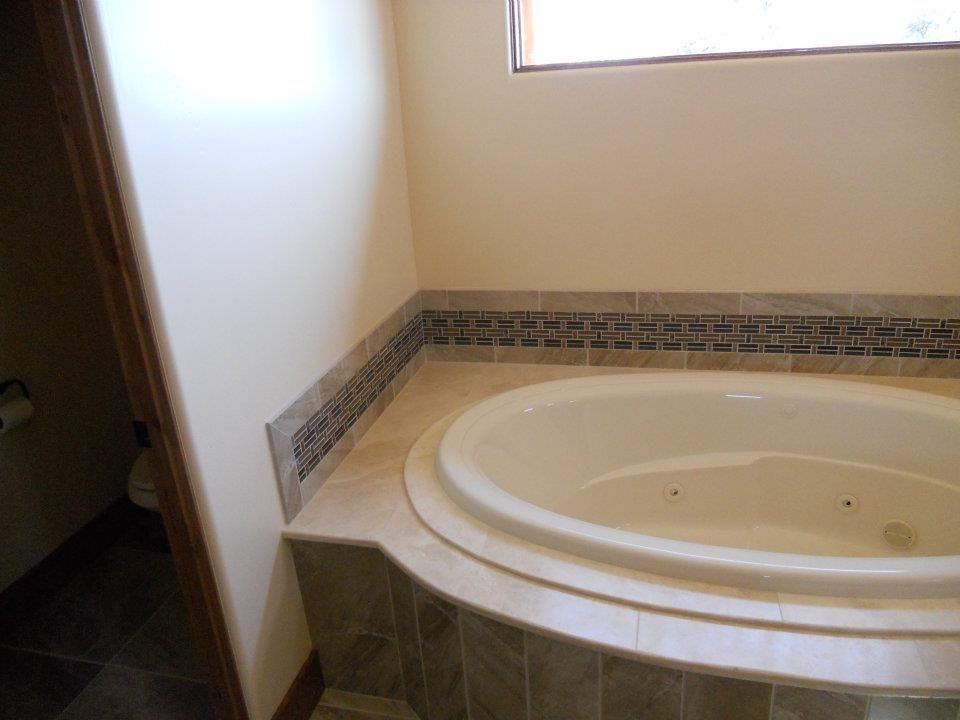 Custom tile tub surround and floor installed by Mingus Tile in ...