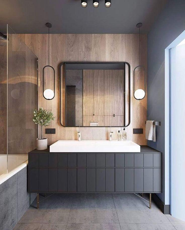 grey bathroom wood panel wall with pendant lighting