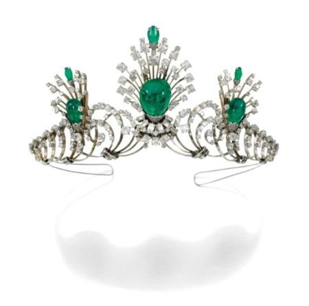 Emerald and Diamond tiara. A series of scrolls with 3 sprays set with cabochon emerald drops and rose, single- and circular-cut diamonds.  Each jewel is detachable and can be worn as a pair of earrings and a brooch. (photo via Sothebys)
