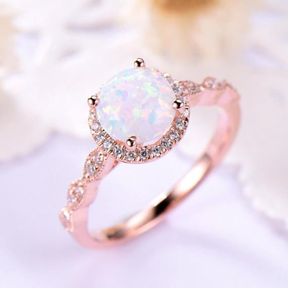 157dae2f46744 This is an opal engagement ring rose gold. The stones are natural ...