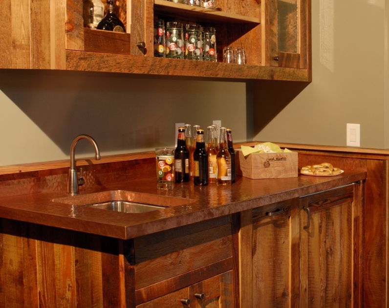 Pounded Copper Countertop With Dawn Colored Cabinets Counters