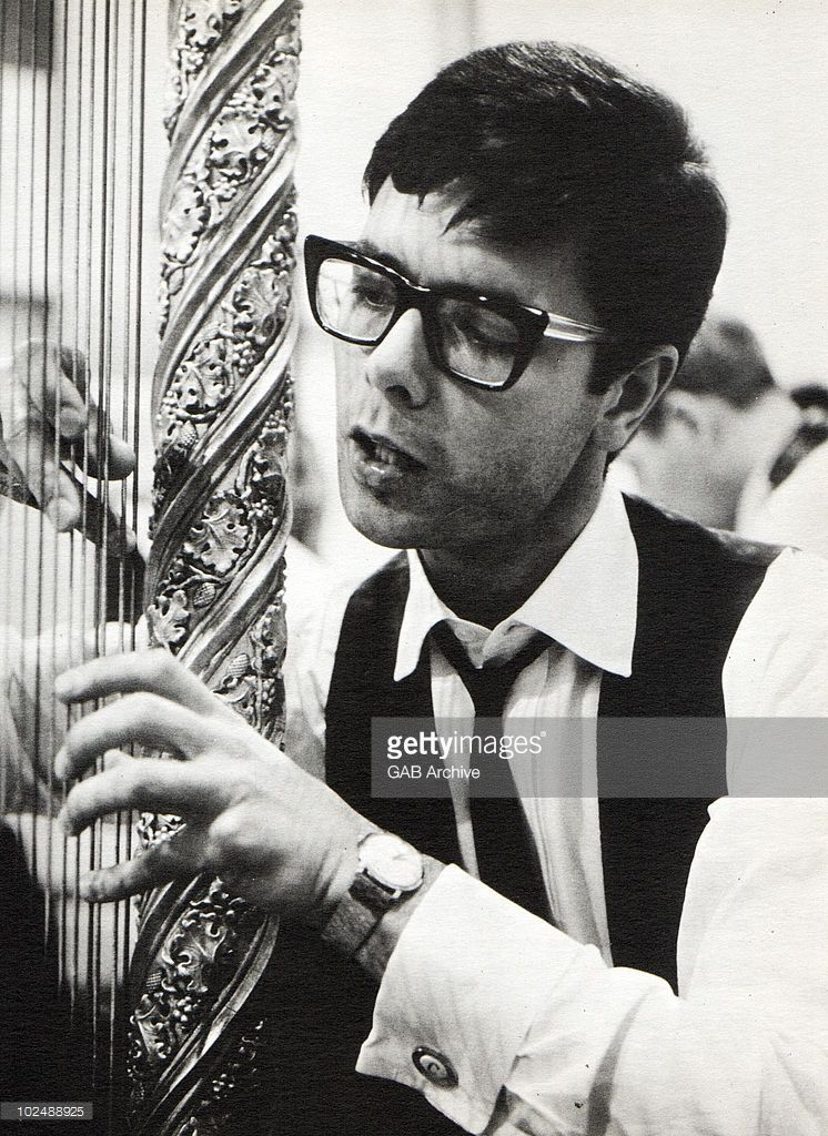 Photo of Cliff Richard playing a harp