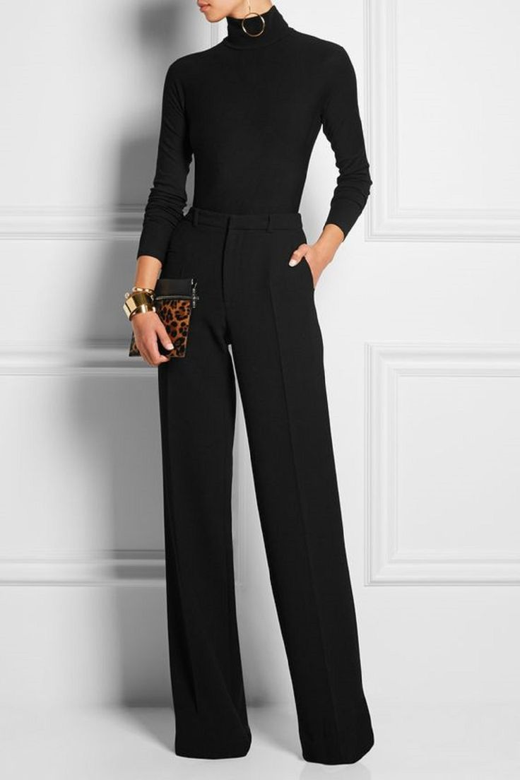 A fitted black turtleneck with wide leg black pants is an ...