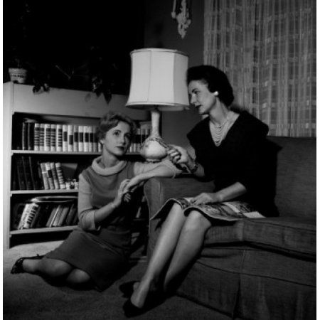 USA Two young women sitting in living room Canvas Art - (18 x 24)