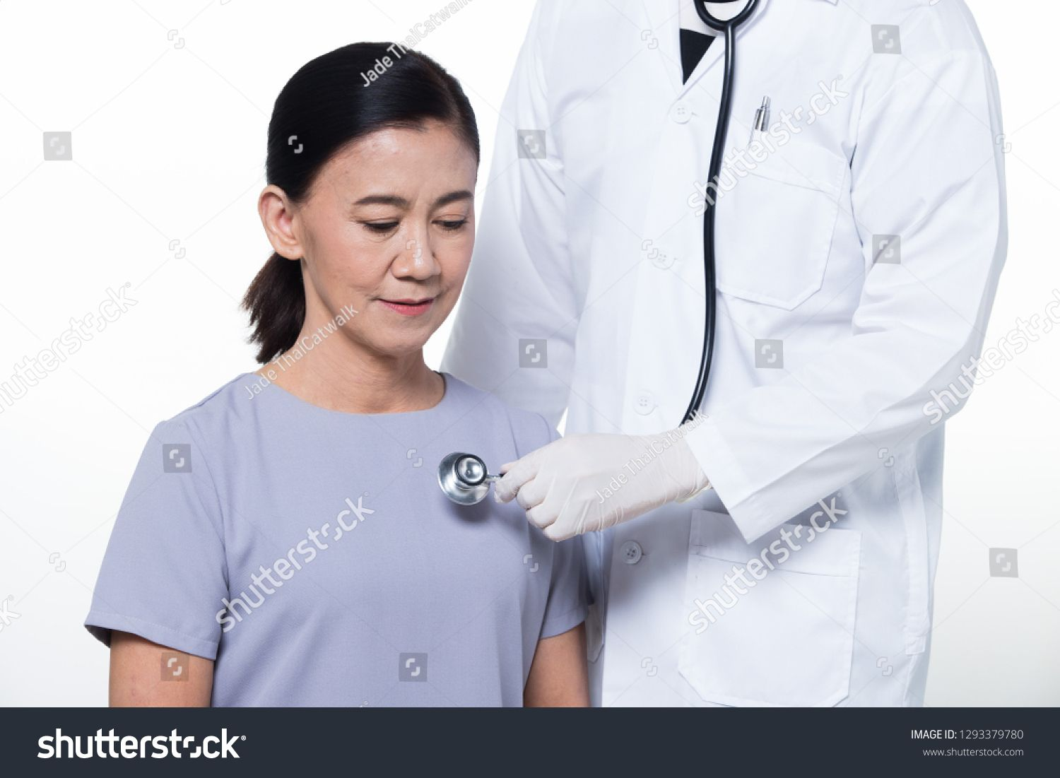 Asian Middle 60s age Woman Patient check up health with ...
