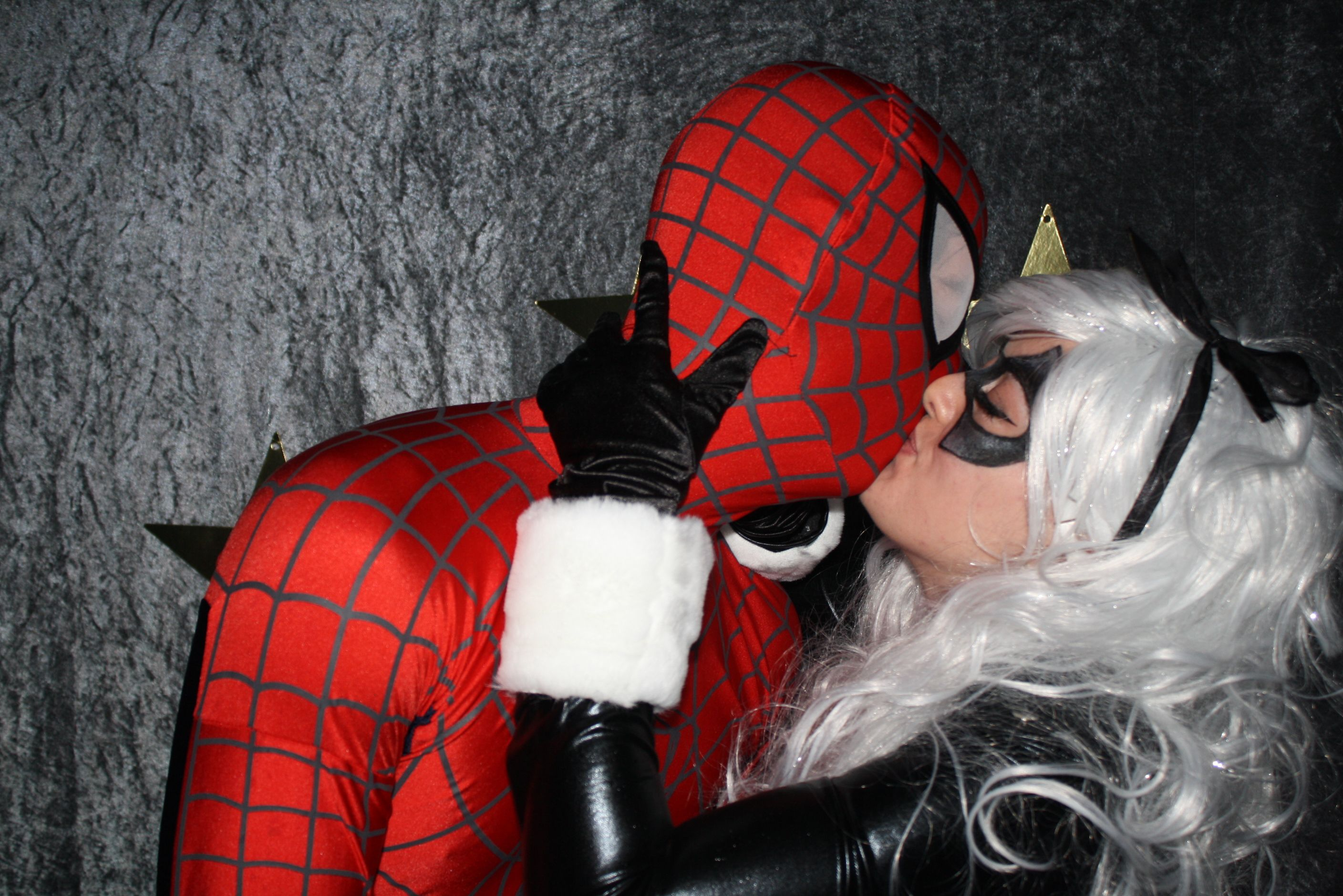 Spidey (Cody)and Black Cat (Amy) kiss at my superhero