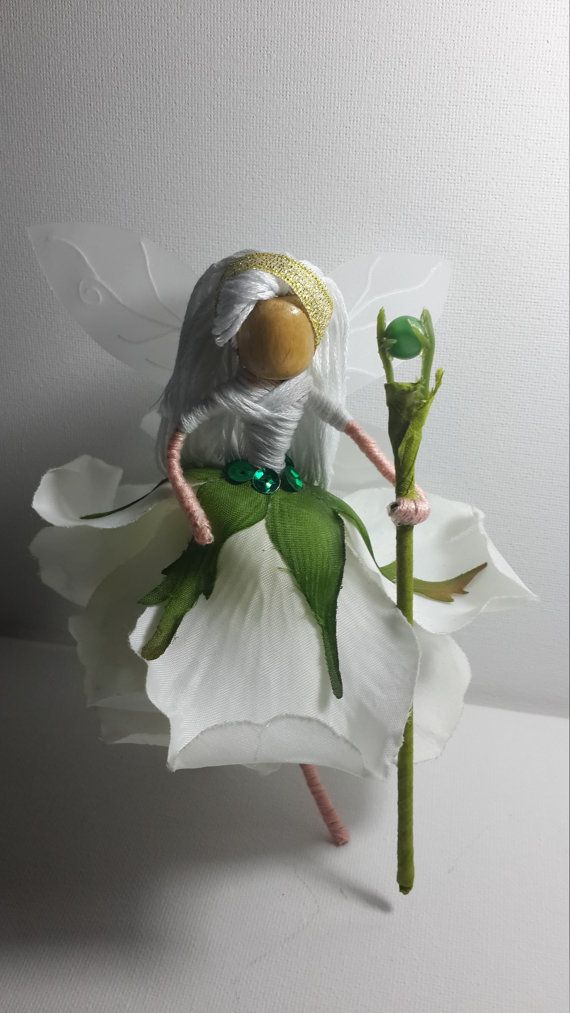 Gorgeous snow queen, in a neat, white rose dress. She wears a glittery gold headband. Includes a green scepter with a bead on the top. Minimalist decoration piece for clean color lovers!  All details are handmade. size 6 x 5.5 inch HxW  ****IMPORTANT: Please read before purchasing. *NOT a toy! Please handle with care and keep out of reach of curious little hands *All of the items are made in a smoke free home. *Not intended for outdoor display. Rain or snow could damage the piece. * Some…