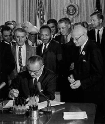 """1964 Lyndon Johnson signing Civil Rights Act """"No person in the United States shall on grounds of race, color, or national origin, be excluded from participation in, be denied the benefits of or be subjected to discrimination under any program or activity receiving federal financial assistance."""" Overnight, it became illegal to force segregation in schools, workplaces, and housing."""