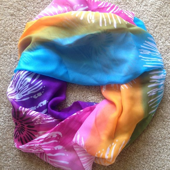 Floral Sarong Wrap / Scarf Multi-colored floral sarong wrap or scarf. Perfect for a swim suit coverup at the beach or pool this spring break and summer! Large enough to wrap in all different ways! Accessories Scarves & Wraps
