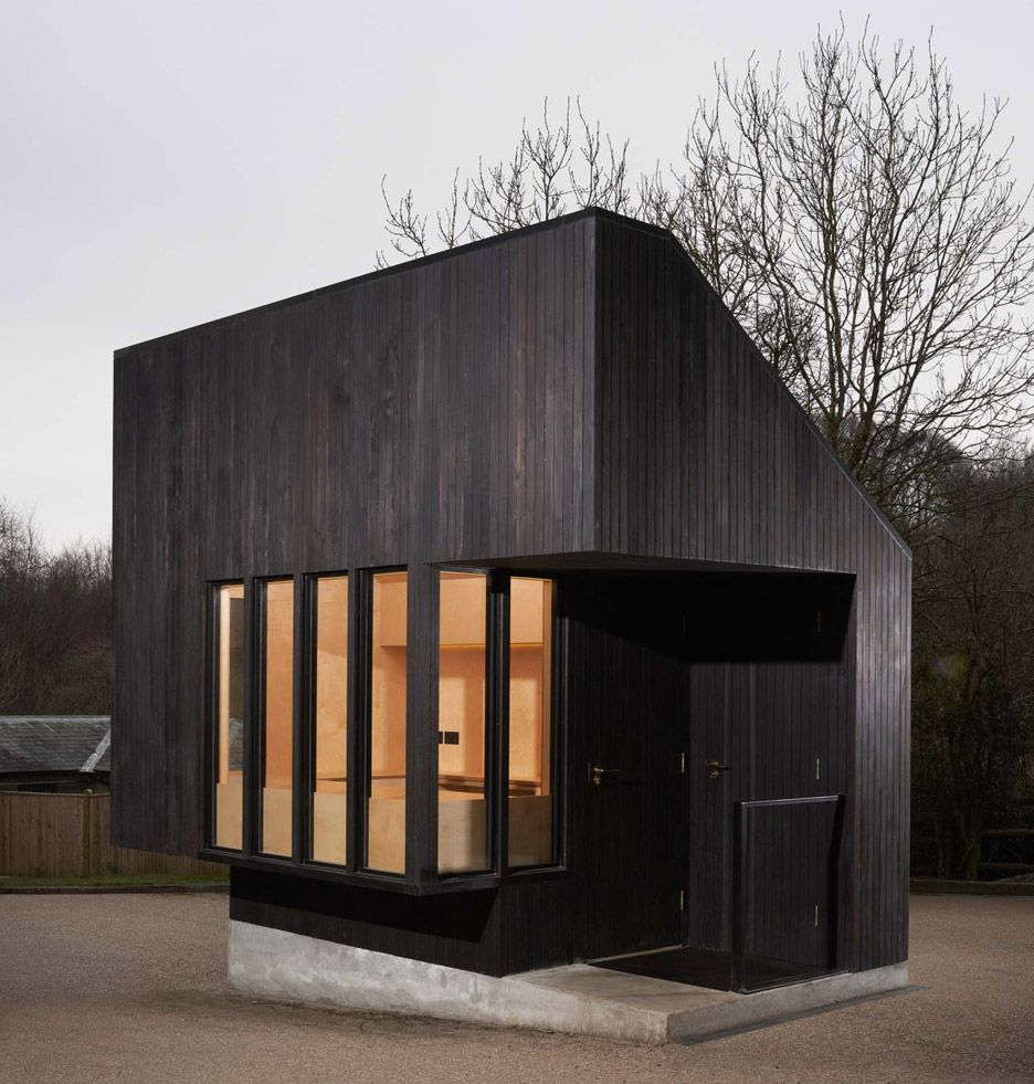 burnt wood clads this gatehouse designed by nord architecture for a historic palace in southeast. Black Bedroom Furniture Sets. Home Design Ideas