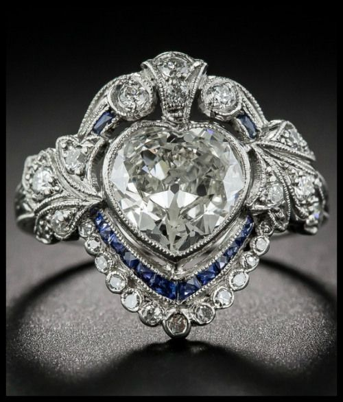 Beautiful antique Edwardian sapphire and diamond ring with a 1.20 carat heart shaped center diamond.