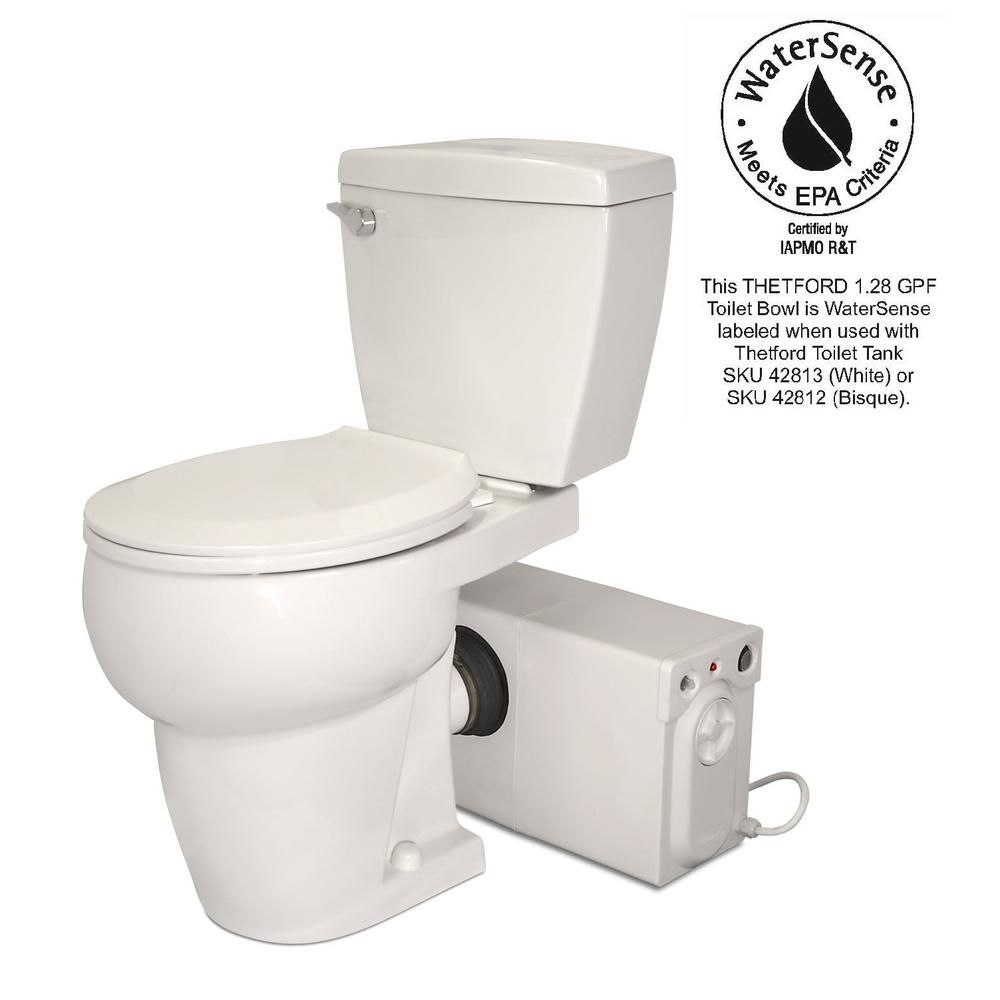 Thetford Bathroom Anywhere 2 Piece 1 28 Gpf Single Flush Round Toilet With Seat Macerating Pump In White 42821 The Home Depot Basement Toilet Toilet Basement Bathroom