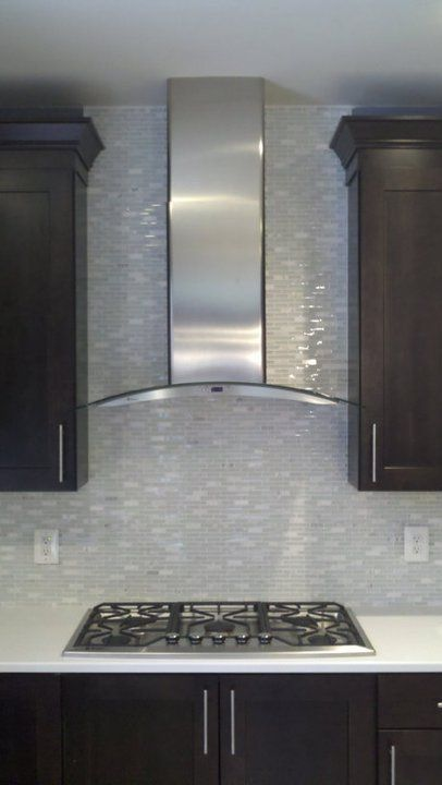 stainless range hood and glass tile backsplash. kitchen #interior